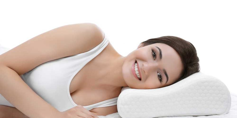 woman lying with pillow